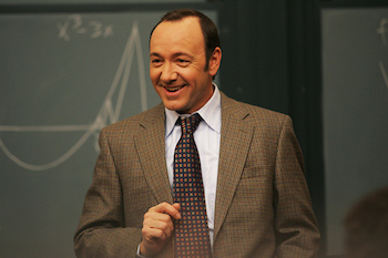 Kevin Spacey solves complex blackjack mathematics problems in the movie 21